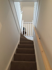 New narrow softwood staircase leading to loft conversion bedroom