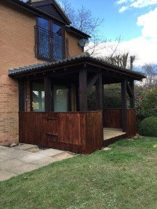 Hardwood / softwood custom garden room to include tiled-hipped roof, timber-decked floor base & integrated hinged access door
