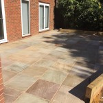 Natural stone with retaining sleeper walls