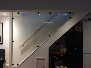 Toughened glazed stairwell with black powder coated glass clamps