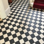 Traditional individual Victorian encaustic tiles laid in a diamond pattern