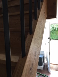Rustic oak staircase incorporating black iron inset spindles & hand carved posts & handrails