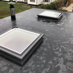 Flat roof covered in EDM rubber incorporating flat glazed roof lights