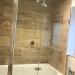 Porcelain wood effect tile with recessed lighting & digital wireless shower & bath filler