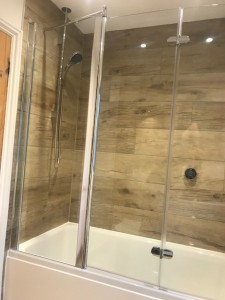 Porcelain wood effect tile with recessed lighting & digital wireless shower & bath filler