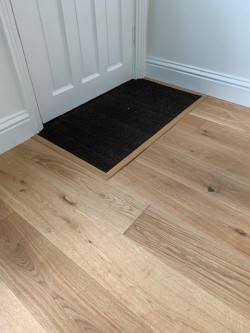 UV natural oiled European engineered oak floor incorporating a sunken charcoal coir mat well