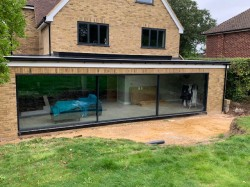 A complete remodel & refurbishment of the existing property / footprint incorporating a rear double storey extension & new master bedroom to 2nd storey including dormer window to front elevation . All external windows & doors are a RAL colour aluminium powder coated frame .
