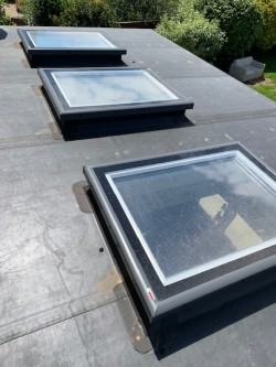 EPDM flat rubber roof incorporating 3 x electric triple glazed flat roof lights
