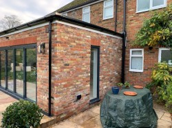 Single storey flat roof extension incorporating a reclaimed stock brick , aluminium slim line bi-fold doors , electric sky-lights & fully bonded  EPDM rubber roof